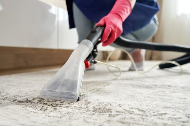 cleaning carpet using vacuum cleaner