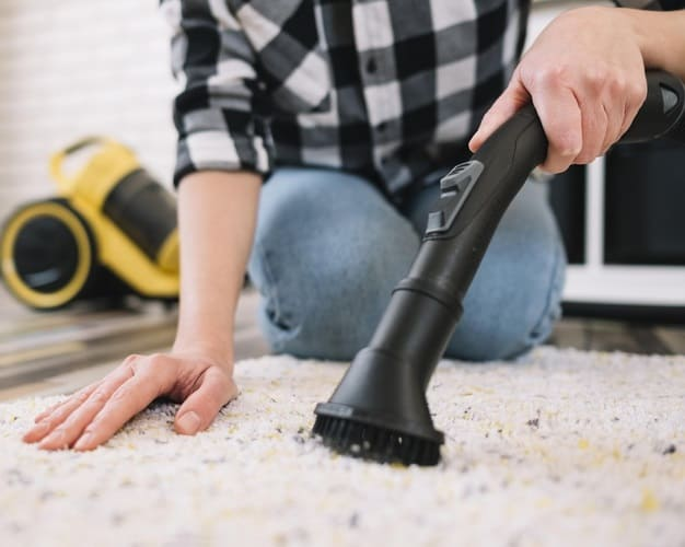 cleaning carpet with vacuum cleaner 1