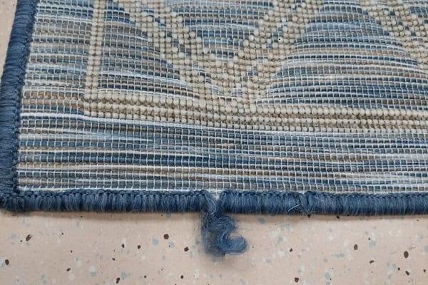 repairing a frayed carpet