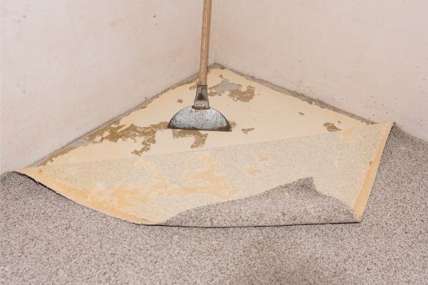 how to remove carpet glue from concrete floors