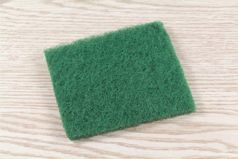 scrubbing pad on wood floor