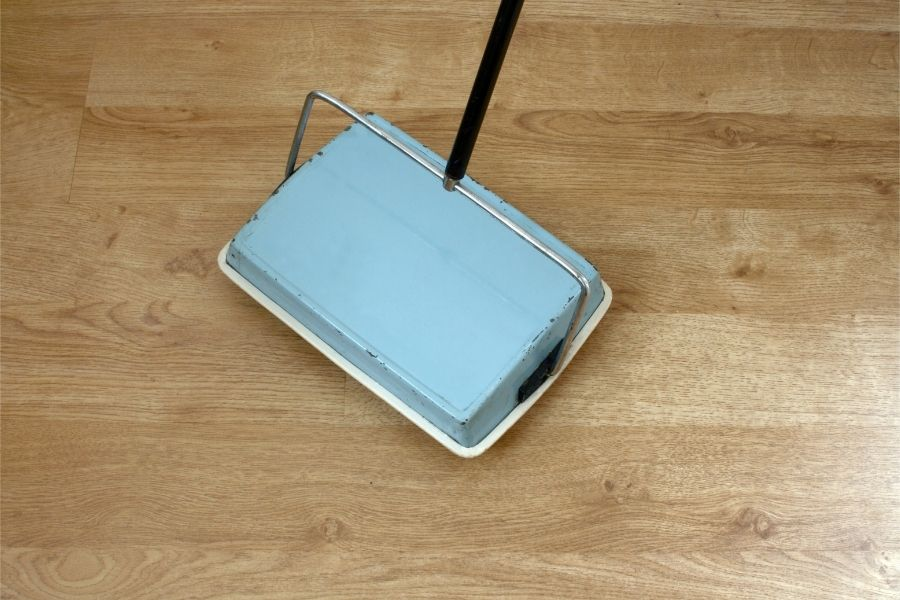 clean carpet with carpet sweeper